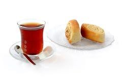 Tea with desert rolls Stock Image