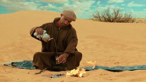 A tea in the desert. Sahara man preparing a tea stock footage