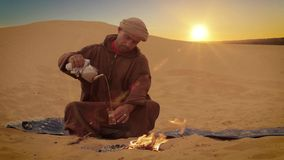 A tea in the desert. Sahara man preparing a tea stock video