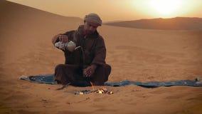 A tea in the desert. Sahara man preparing a tea stock video