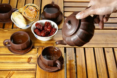 Tea and dessert Stock Images