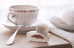 Tea and the dessert. Still life: tea and marshmallow cakes Stock Image