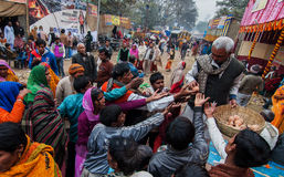 Tea distributed to Hindu devotees at transit camp Royalty Free Stock Photos