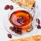 Tea from a dogrose with piece of cake Royalty Free Stock Images