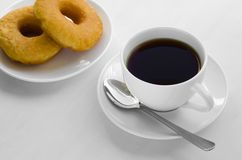 Tea and Donut for Relaxing Time. Hot black tea and donuts are easy appetizer for eating on the time of relax Stock Photos