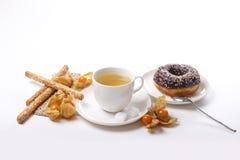 Tea , donut, sesame cookies and physalis. Tea , donuts, sesame cookies and physalis Stock Images