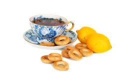 Tea and dray rings cookies and lemons. Stock Photography