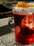 Tea with dried apricots. Red tea with dried apricots Stock Photography