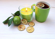 Tea with dried citrus and candle Royalty Free Stock Image