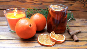 Tea with dried citrus and candle Stock Photos