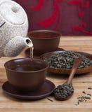 Tea drink. Filling tea bowls stock photos