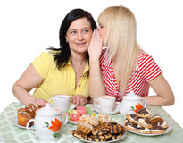 Tea drinking. Mother the daughter talk behind a table to sweets Royalty Free Stock Images