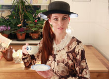 Tea drinking. The girl dressed in English style, drinks tea stock photo