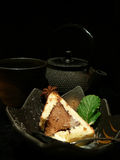 Tea-drinking in black. Tea-drinking still life with anisis cake & black metal teapot in Japanese style Royalty Free Stock Photography