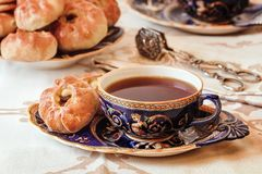Tea drinking. Delicious homemade pies with freshly brewed tea fr stock images