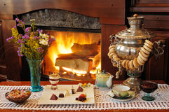 Tea drinking at a fireplace Stock Photos