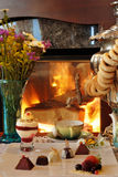 Tea drinking at a fireplace Royalty Free Stock Photography
