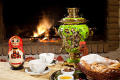 Tea drinking at a fireplace. Russian tea drinking at a fireplace with samovar Stock Photos