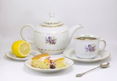 Tea time. Hot tea with cake & lemon Royalty Free Stock Photography