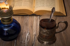 Tea drinking  by the light of an old oil lamp. Stock Images