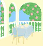 Tea-drinking in spring garden. Covered table for tea-drinking on terrace in spring garden Royalty Free Stock Images