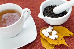 Tea and drugs Stock Images