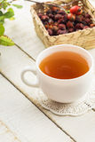 Tea with dry briar Stock Image