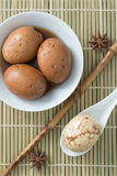 Tea egg on a bamboo mat, top view.  royalty free stock images