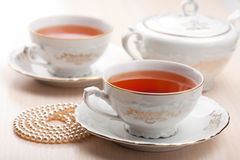 Tea in elegant cups Royalty Free Stock Image