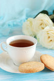 Tea in elegant porcelain cup and shortbread Stock Photography