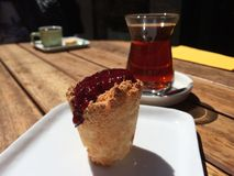 Tea on table. Cupcake and turkish tea at nisantasi street Royalty Free Stock Image