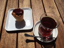 Tea on wooden table. Cupcake and turkish tea at nisantasi street Stock Photos