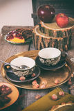 Tea equipment on vintager kitchen table Royalty Free Stock Image