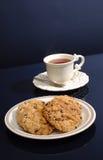 tea för kakagruppplatta Arkivbilder