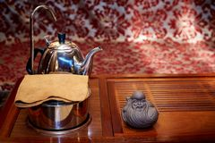 Preparation for the tea ceremony. Napkin, teapot, toy for tea ceremony on a wooden board royalty free stock photos