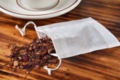 Tea filter bag with rooibos tea stock photography