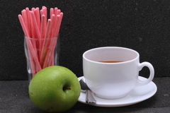 Tea,finger stick biscuit and green apple Stock Photography