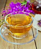 Tea from fireweed in glass cup on board Royalty Free Stock Images