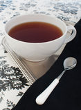 Tea on floral pattern Stock Photography