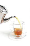 Tea flow to cup Royalty Free Stock Photos
