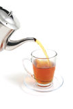 Tea flow to cup Royalty Free Stock Image