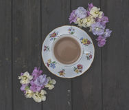 Tea and flowers. Delicate pastel coloured flowers and bone china royalty free stock photography