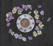Tea and flowers. Delicate pastel coloured flowers and bone china stock photos
