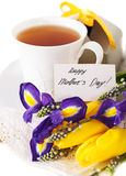 Tea with flowers and gift box for mom Royalty Free Stock Photos