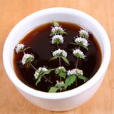 Tea with flowers of peppermint Royalty Free Stock Images