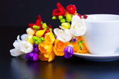 Tea with freesia. Natural tea in white cup flowers with freesia holiday background Royalty Free Stock Images