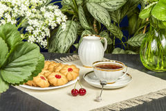Tea fresh biscuits with cherries. On the table in the morning on nature Royalty Free Stock Image