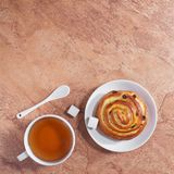 Tea and fresh bun Royalty Free Stock Image
