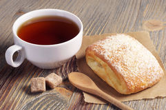 Tea and fresh bun Royalty Free Stock Photo