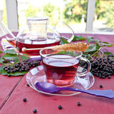 Tea with fresh elder berries Stock Photos